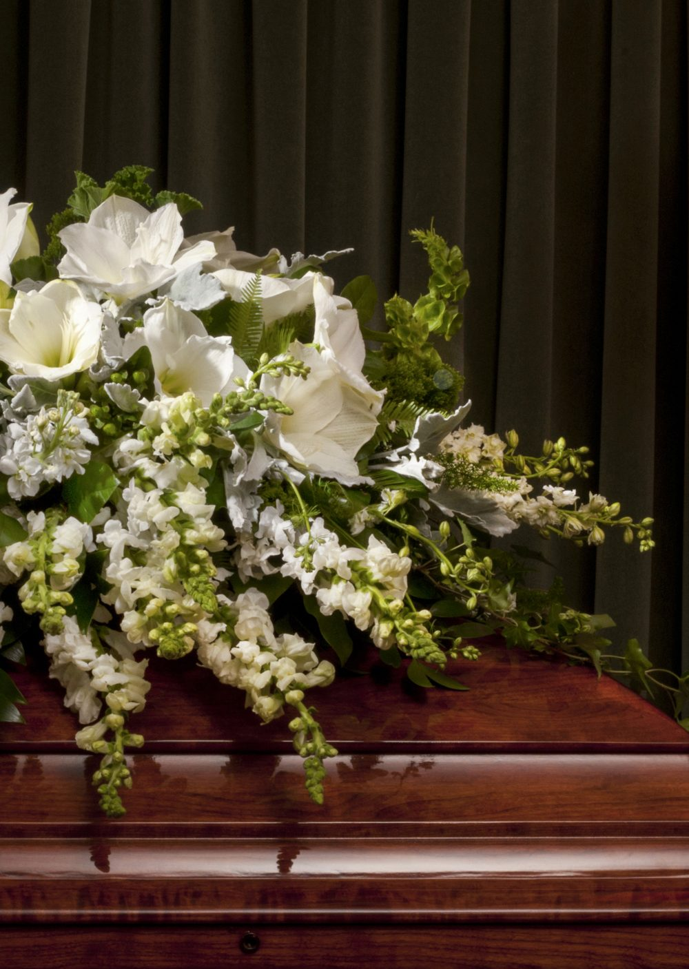 Lush beautiful fresh flower casket sprays for full or half casket funeral, designed to rest on top of casket.