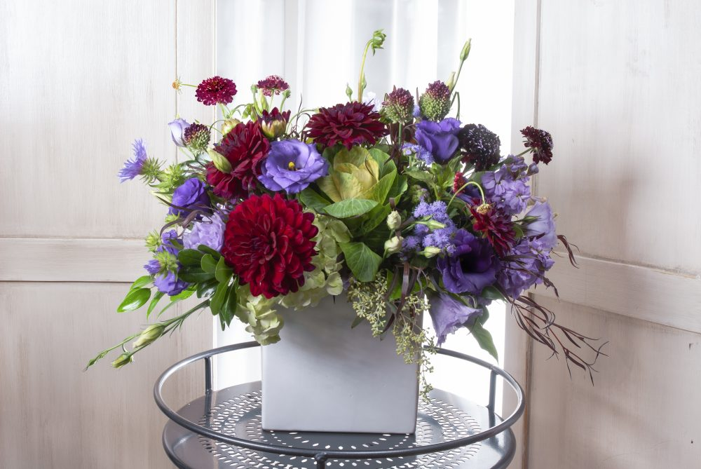 Bold jewel tones in amethyst, wine, and bright green, striking gift fresh flowers summer arrangement.