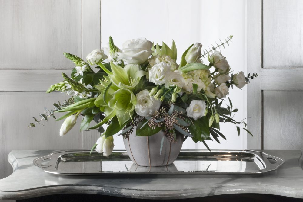 Fresh flower arrangement in crisp whites and greens