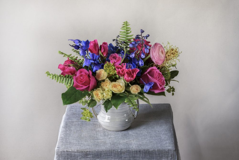 Bright spring flowers arranged in our petite ceramic pot.