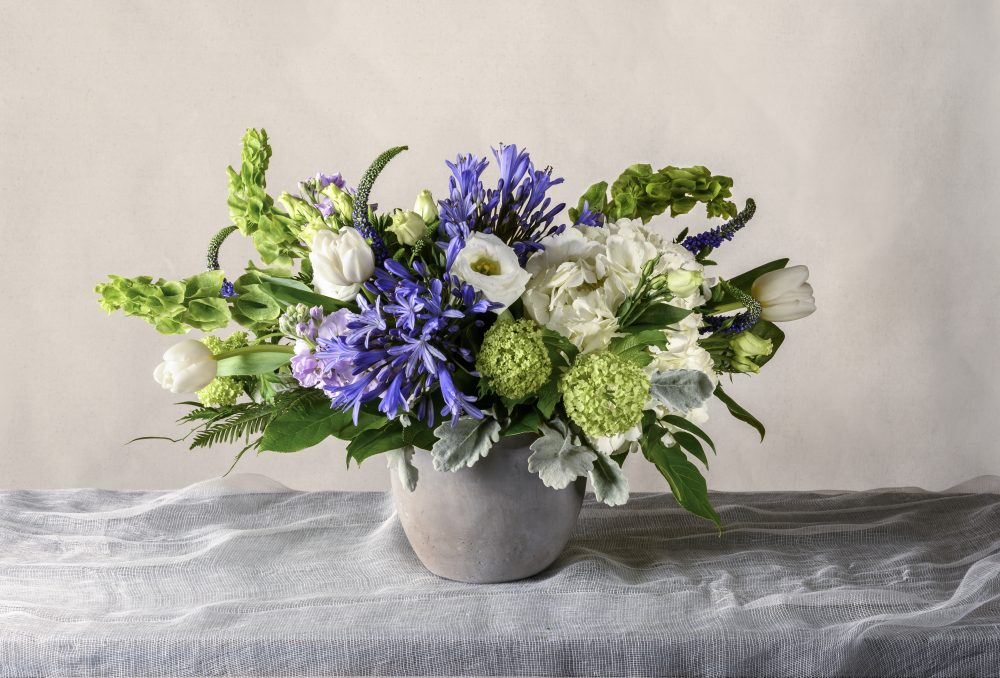 Spring fresh flower arrangement in bright purple and green
