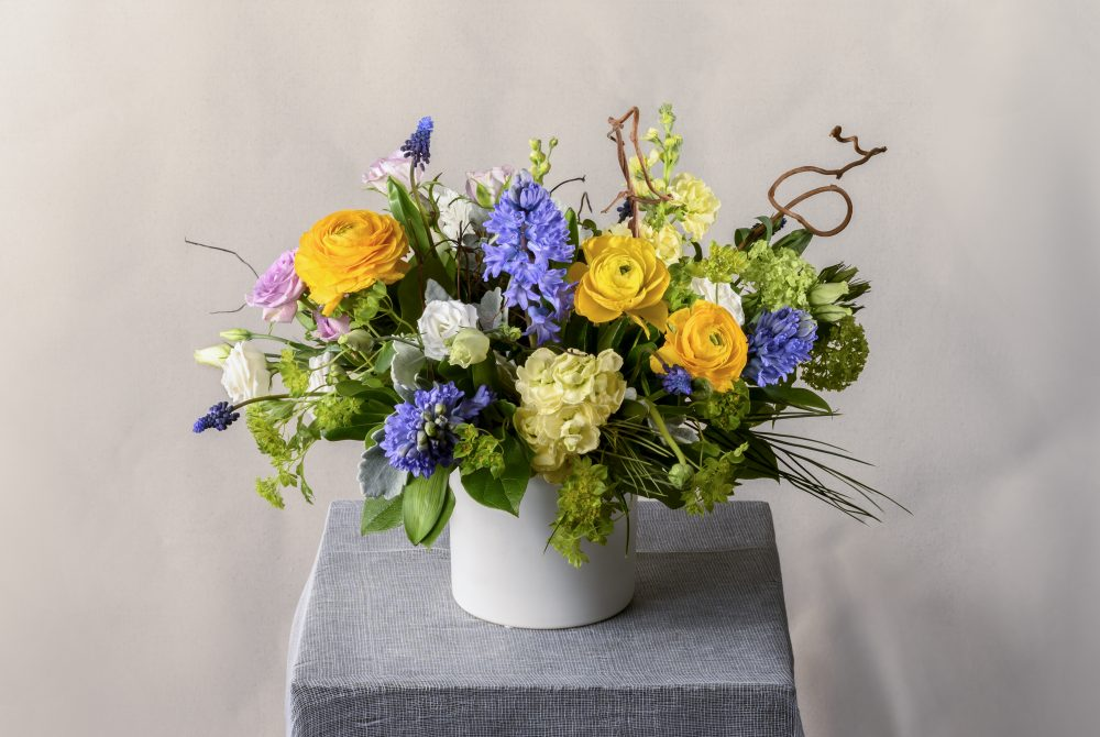 Arrangement of fresh flowers in spring colors