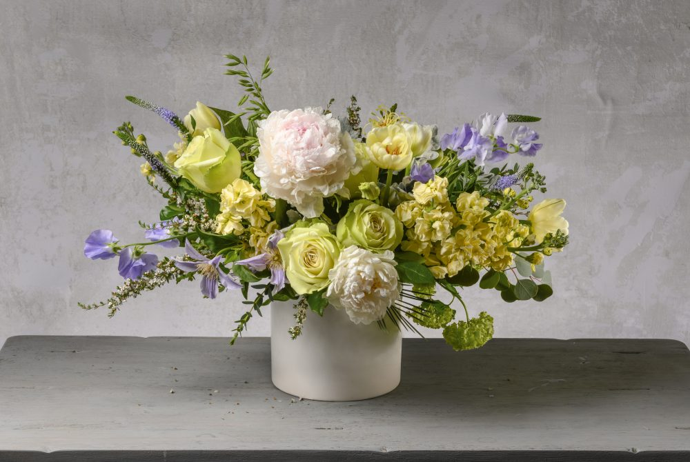 A fresh flower arrangement for Mother's Day with pastel yellow and lavender.