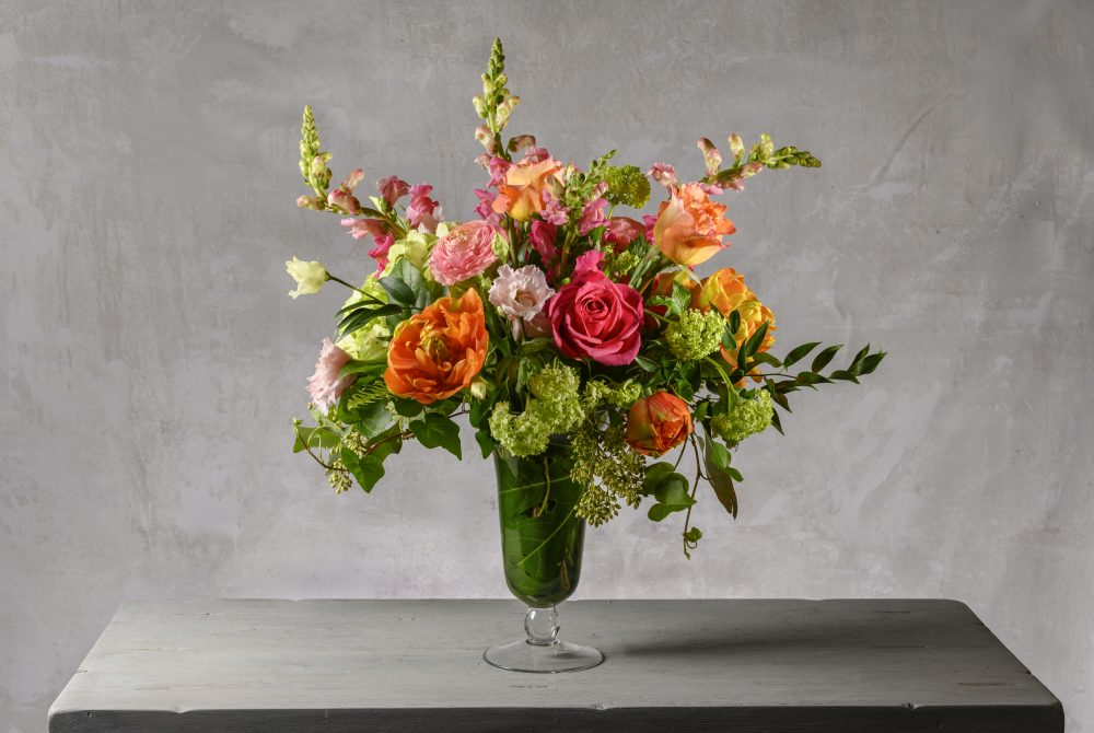 Mother's Day arrangement of fresh flowers in vibrant spring colors.