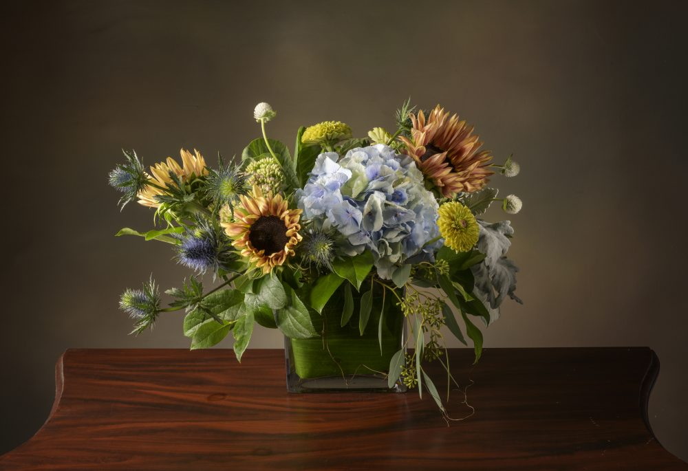 Autumn arrangement of fresh field flowers and soft antique blues