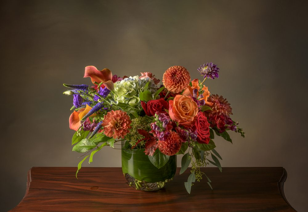 Bright arrangement of fresh flowers in vibrant autumn colors.
