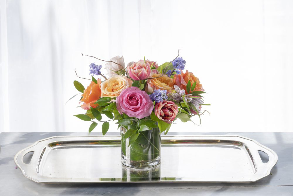 Soft autumn colors flower arrangement in a unique artisan box