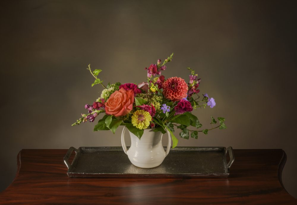 Bright autumn blossoms in a petite fresh flower arrangement.
