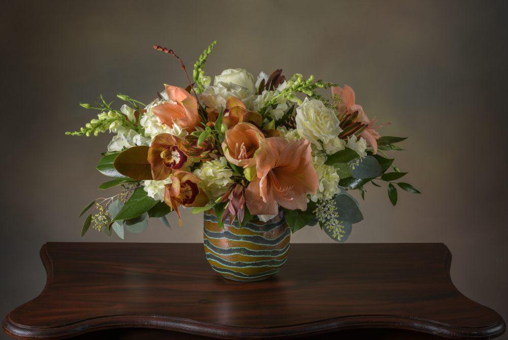 Fresh autumn pastel flower arrangement in artisan glass.