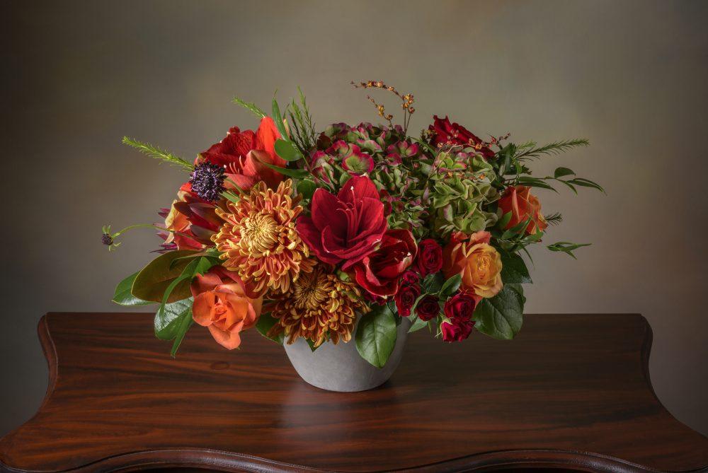 Fresh flower arrangement in bold autumn colors.