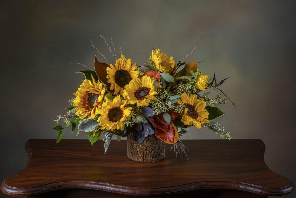 Bright autumn sunflowers inborn pot