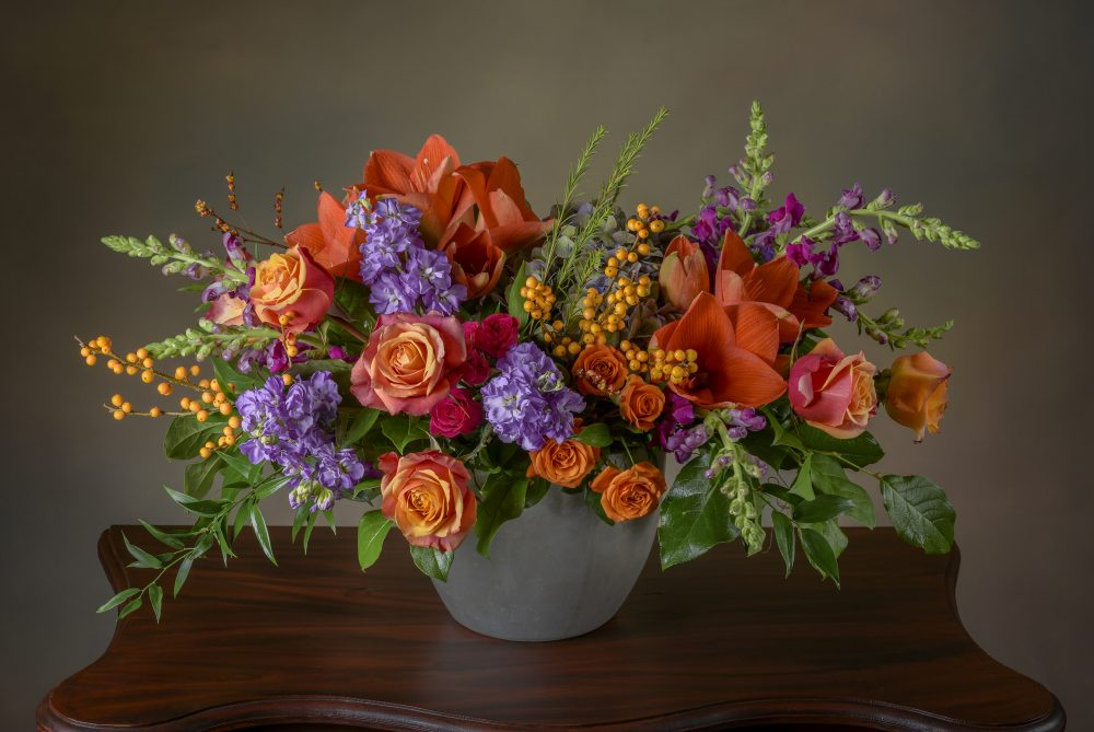 Bright arrangement of fresh flowers in autumn colors.