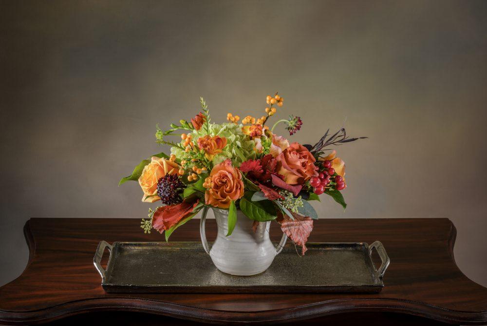Bright autumn blossoms in a petite fresh flower arrangement