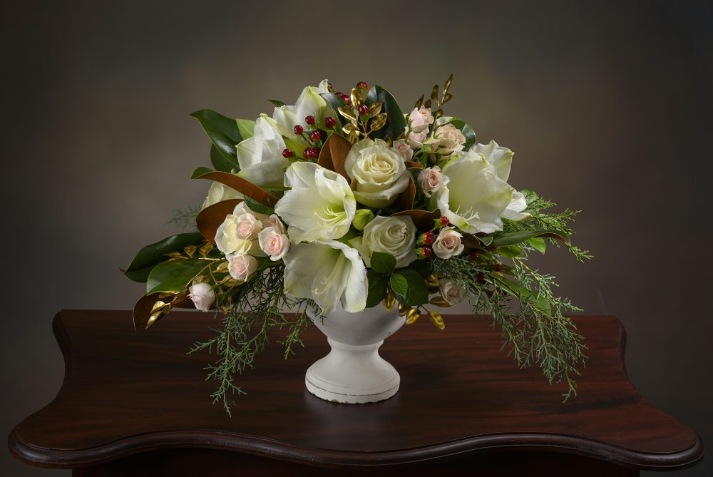 Lush winter white flower arrangement with accents of gold