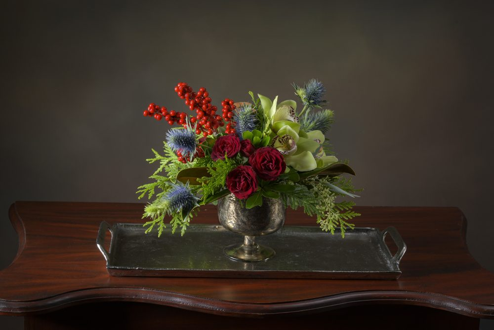 Rich holiday color with flowers and berries