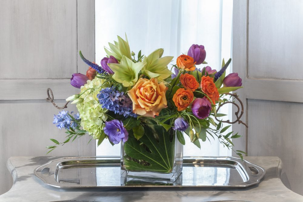 Vibrant spring blossoms in a fresh flower arrangement.