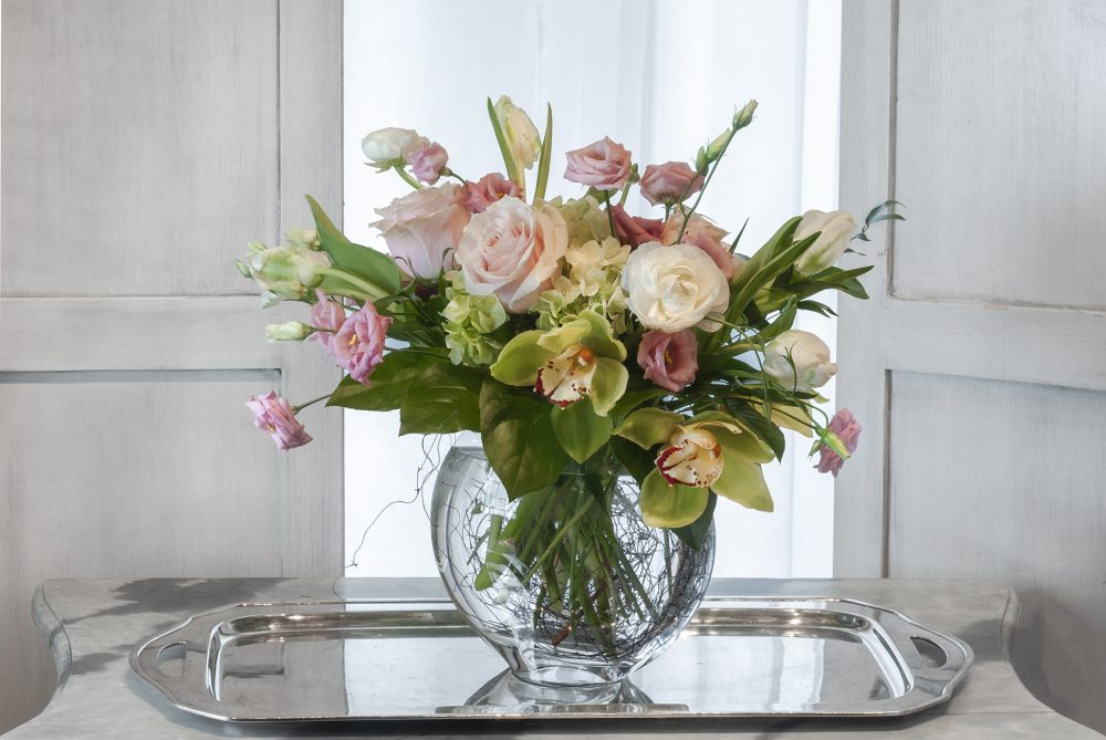 Soft spring blossoms in a fresh flower arrangement.