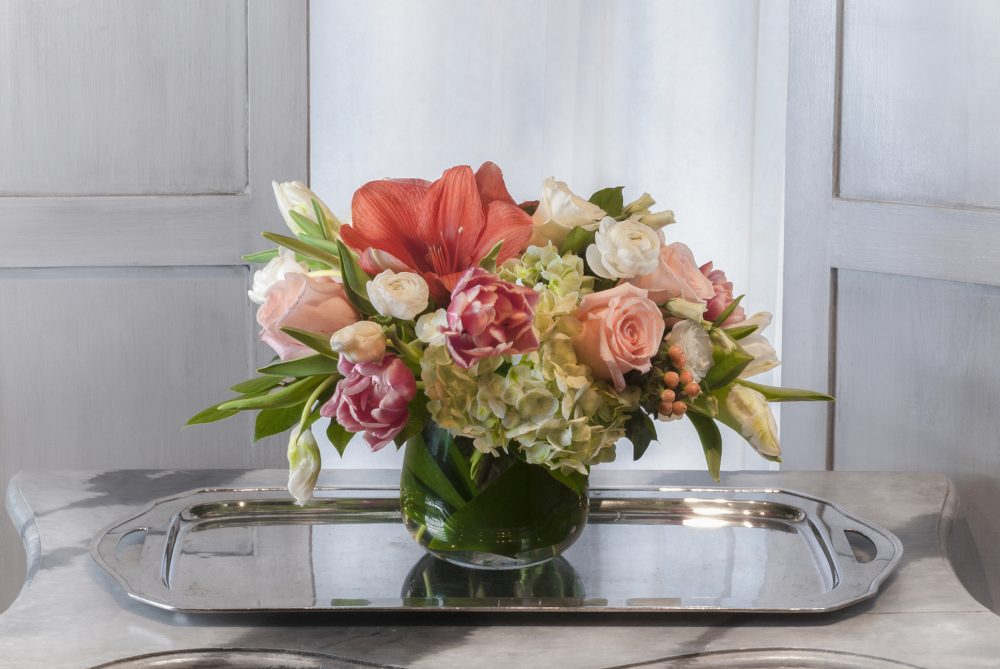 Bright spring blossoms in a fresh flower arrangement.