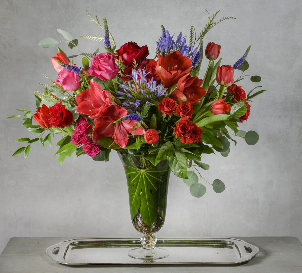 Vibrant hues of spring in purple and lavender blossoms in a fresh flower arrangement.