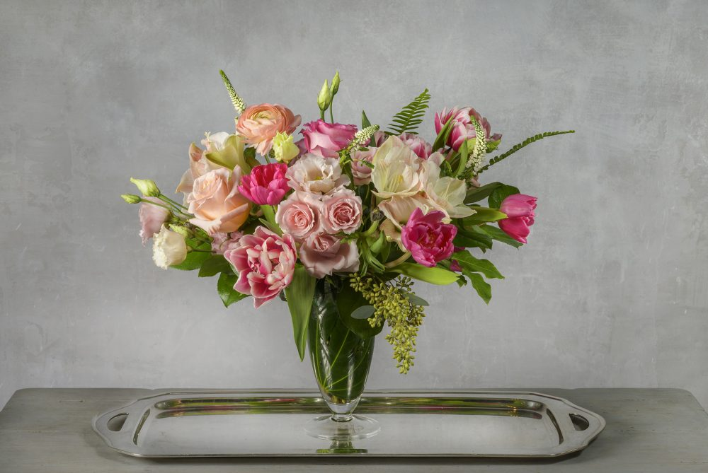 Valentine fresh flower arrangement in bright and pastel blooms.