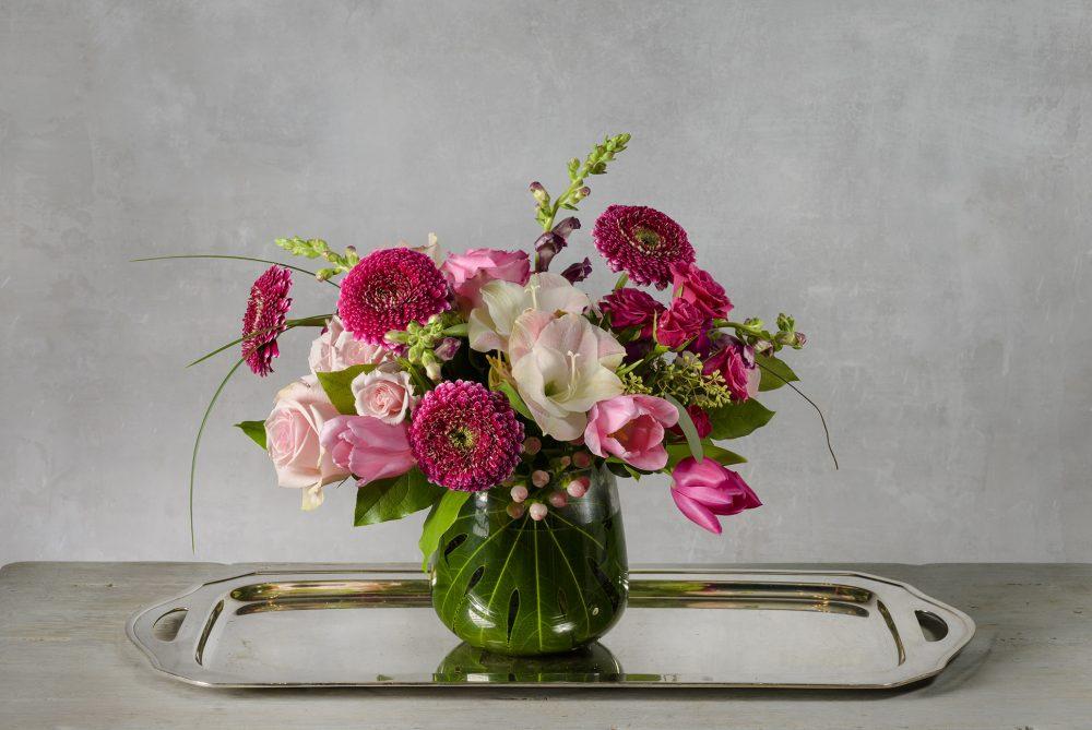 Bright pink and pastel fresh flower gift in a Valentine arrangement.