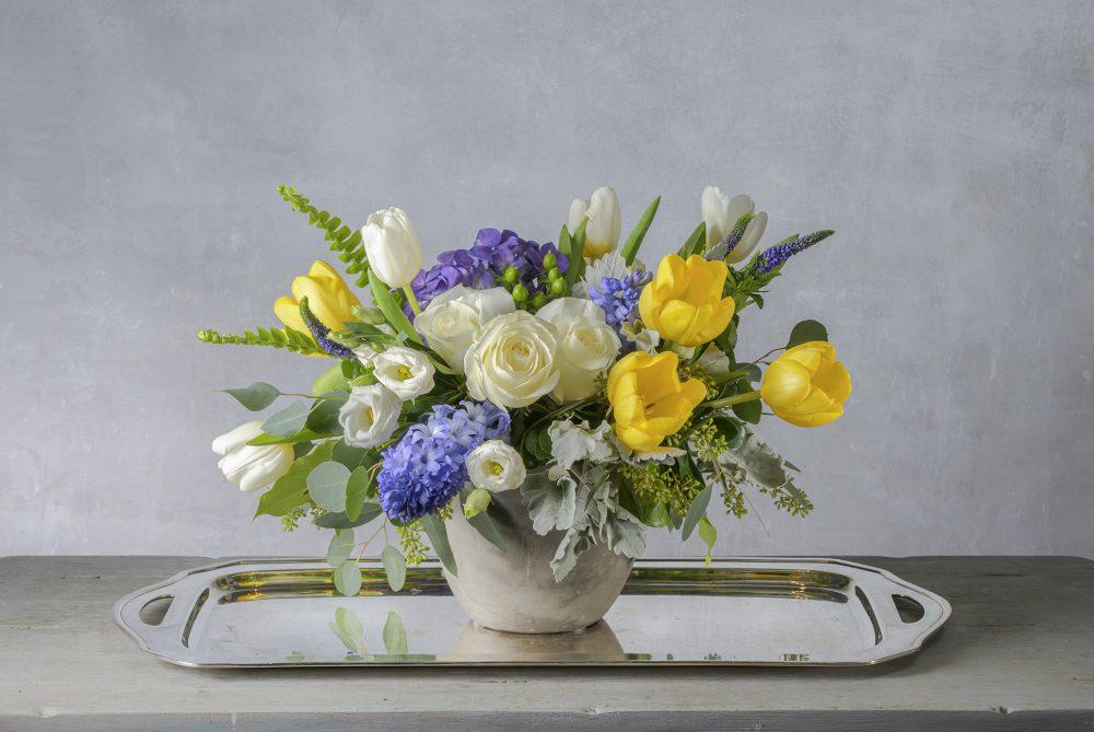 Vibrant spring blossoms in a fresh flower arrangement.