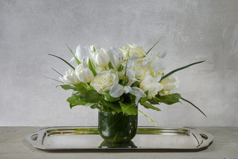 Crisp white spring blossoms in a fresh flower arrangement.