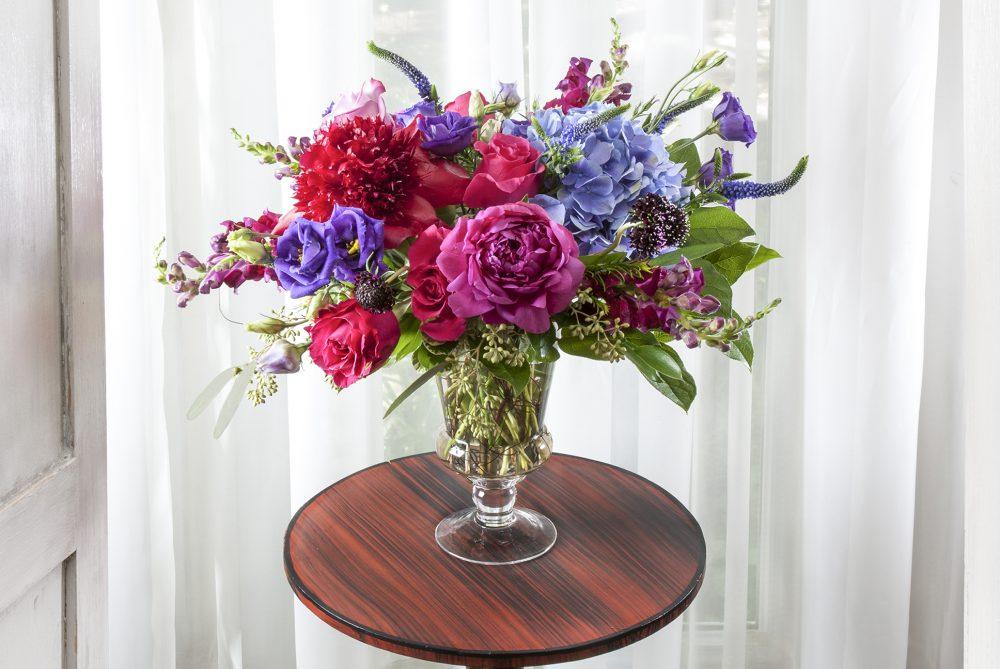 Unique fresh flower arrangement in a taller design of vibrant spring