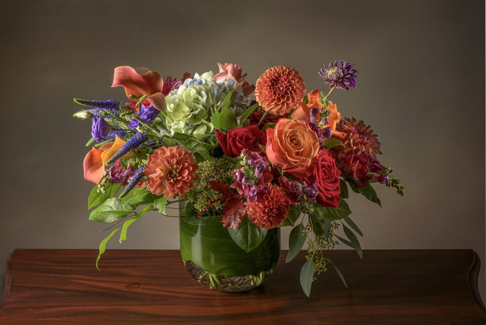 Bright arrangement of fresh flowers in vibrant autumn colors delivered
