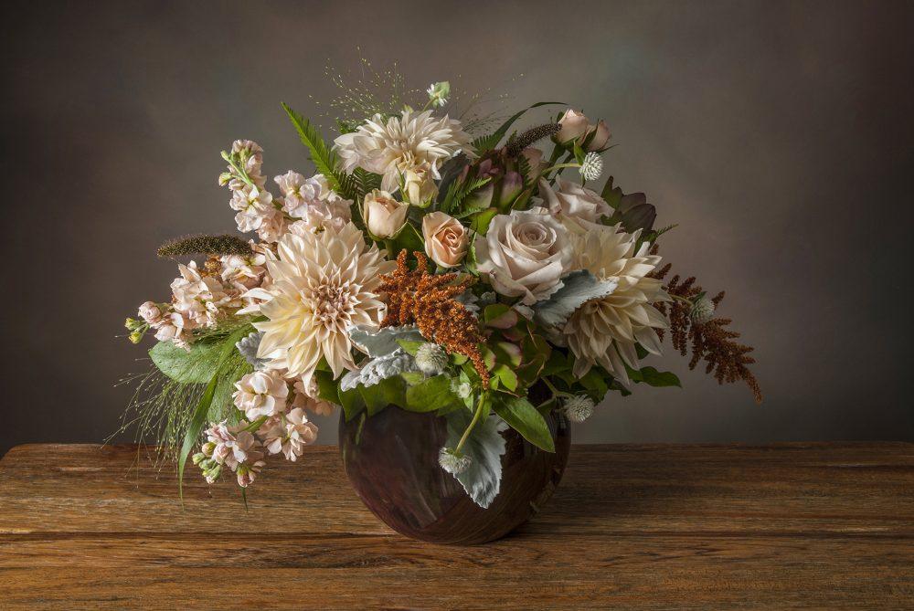 Unique soft blush pastel arrangement of fresh seasonal flowers delivered