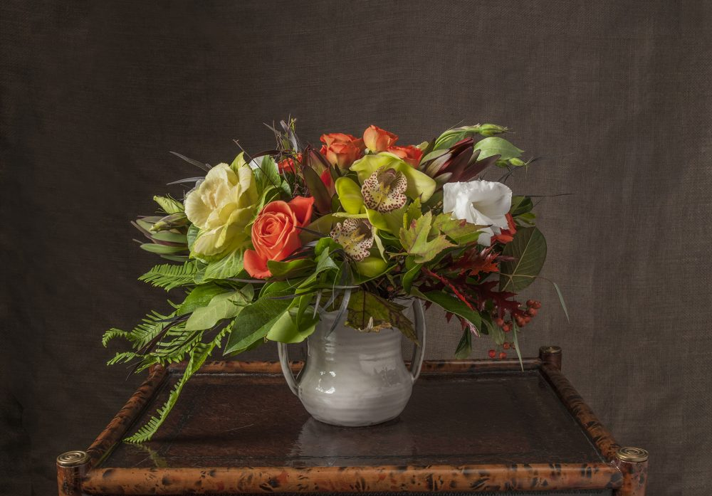 Bright autumn blossoms in a petite fresh flower arrangement gift delivered