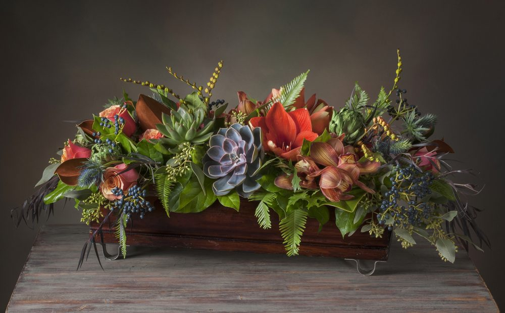 Fresh flowers in autumn colors Thanksgiving centerpiece in a handmade artisan box