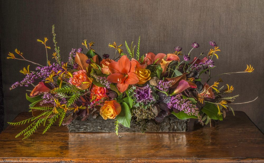 Fresh flowers Thanksgiving centerpiece in colorful autumn flowers with berries