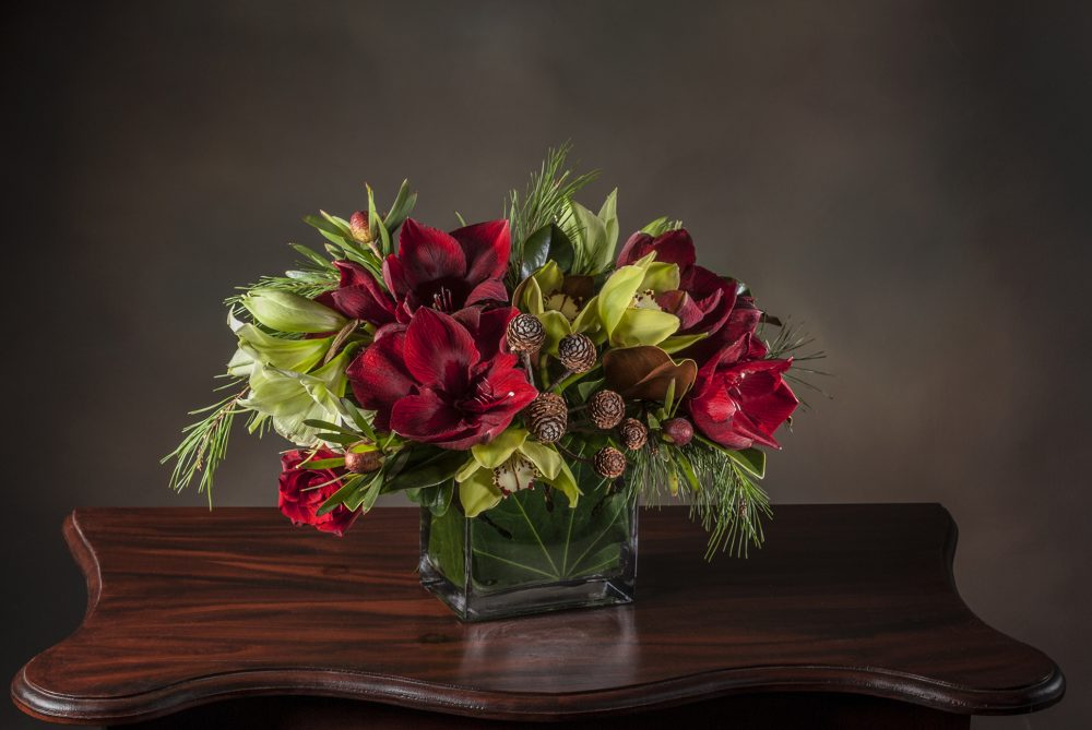 Unique seasonal fresh flowers in a striking holiday arrangement delivered.