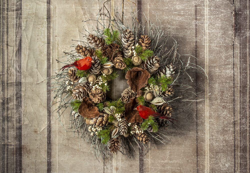 Birch twig wreath with cones, berries, pods, and accented with faux evergreens and feathered birds, delivered