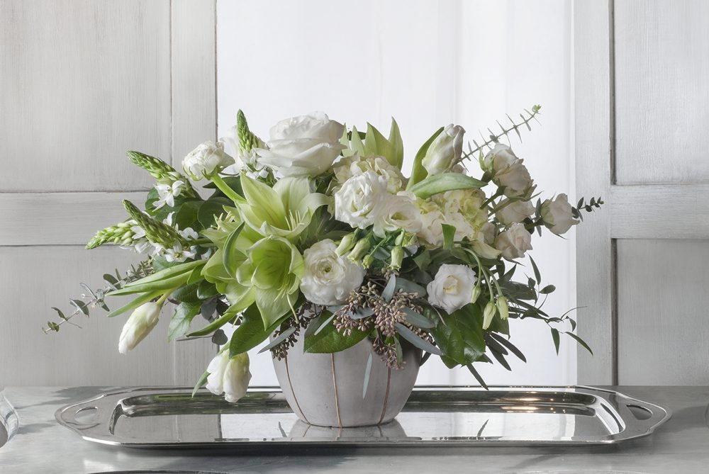 Unique seasonal fresh flower arrangement in winter whites and greens delivered.