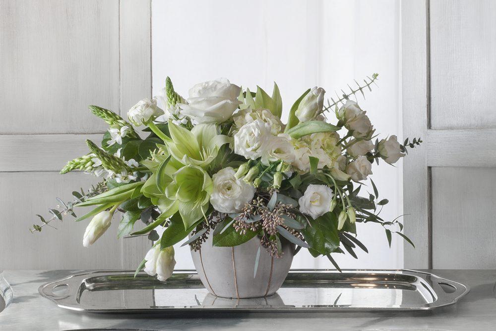 Unique spring fresh flower arrangement in whites and greens delivered.