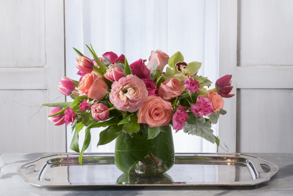 Cheerful flower arrangement in coral, peach, and pink blooms delivered cincinnati.
