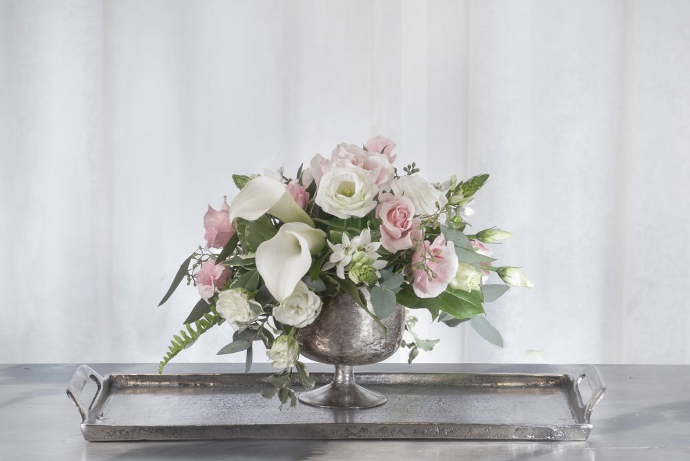 Elegant white with pale pink fresh flowers arranged in an aged mercury compote delivered cincinnati.