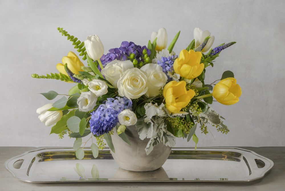 Fresh flowers for a spring arrangement of bright colors yellow, purple, white blossoms.
