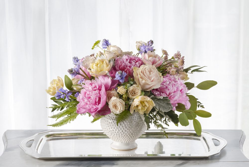 Mother's Day fresh flower arrangement delivered in Cincinnati with peonies and lavender accent flowers in a white ceramic pot as a unique gift
