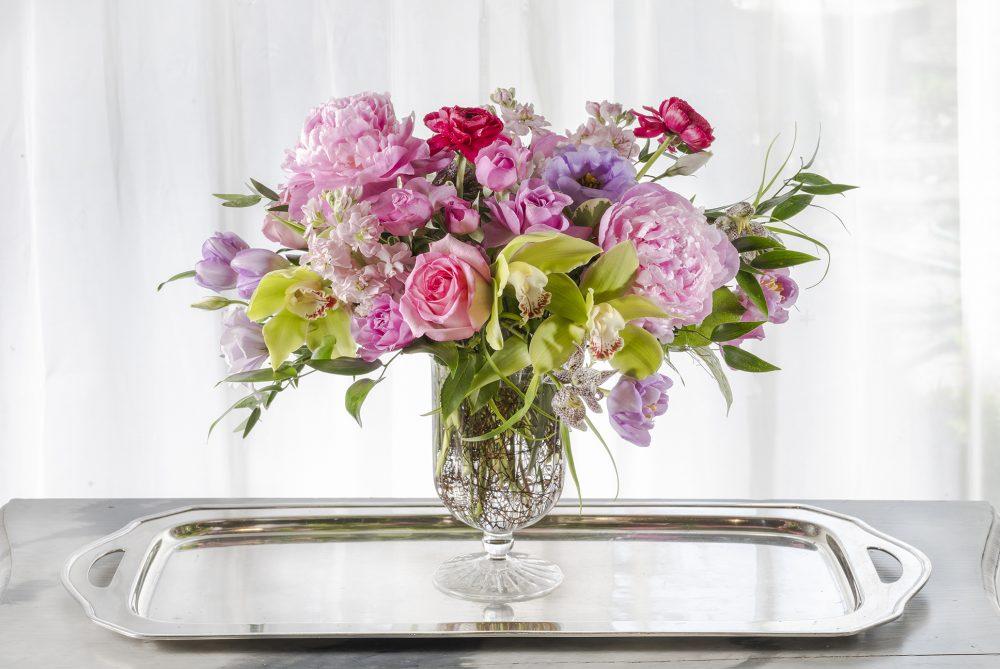 Mother's Day fresh flower arrangement delivered pink peonies lavender spring flowers in a pedestal vase