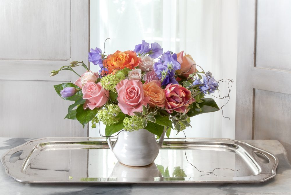sweet and unique gift of fresh flowers in bright spring colors