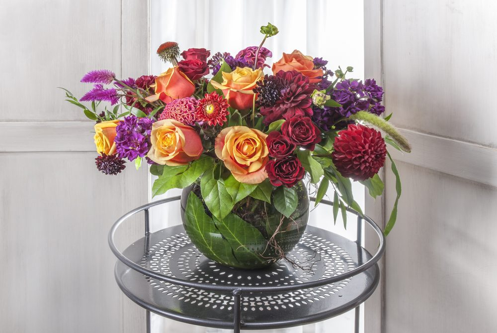 Vibrant lush fresh flowers bold summer colors in deep reds, orange, magenta, purple, fun gift, delivered