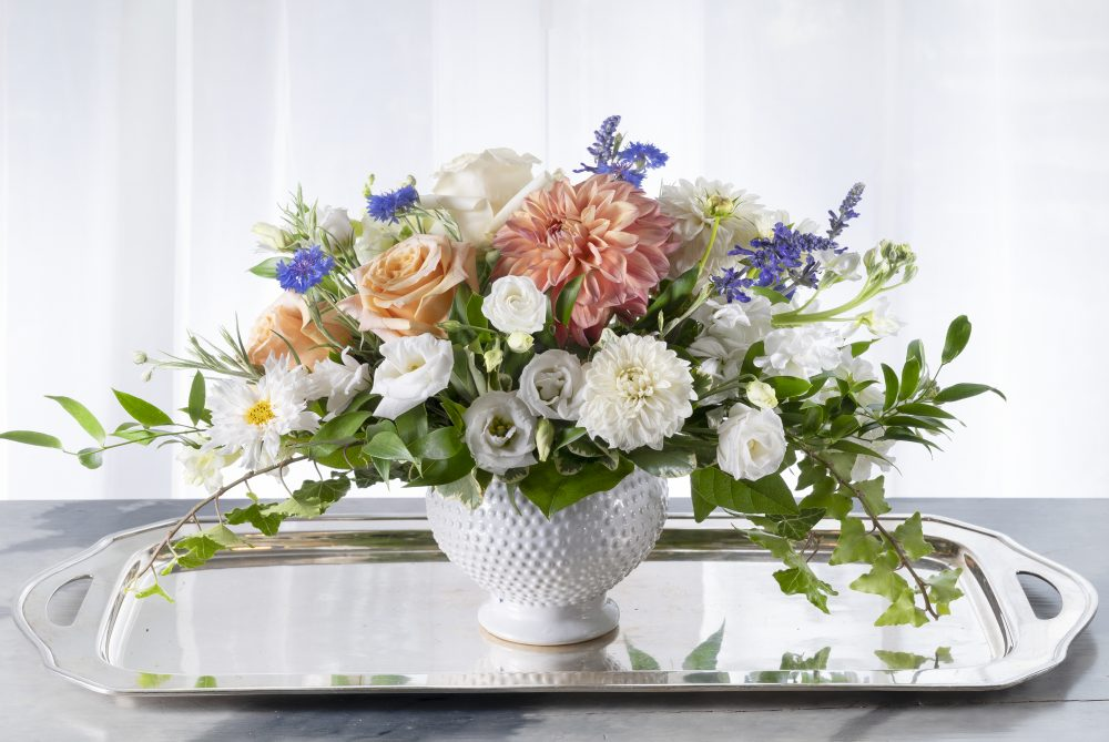 Pretty peach, white, lavender accent fresh flowers summer arrangement for gifting.